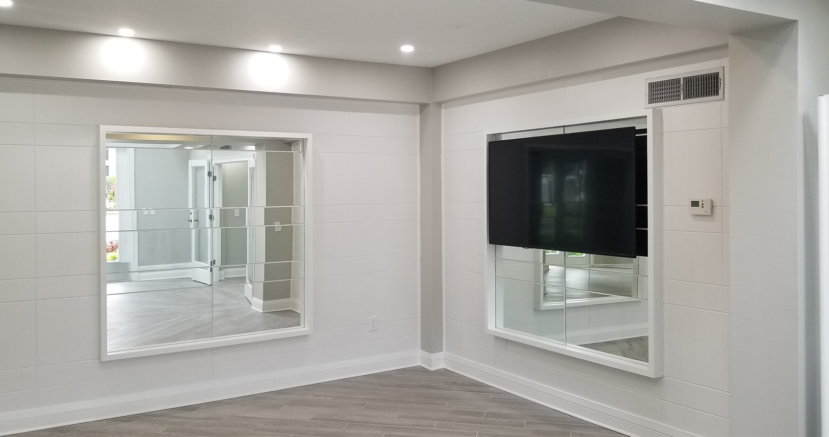 Arbors at Carrollwood interior renovations with mirrors
