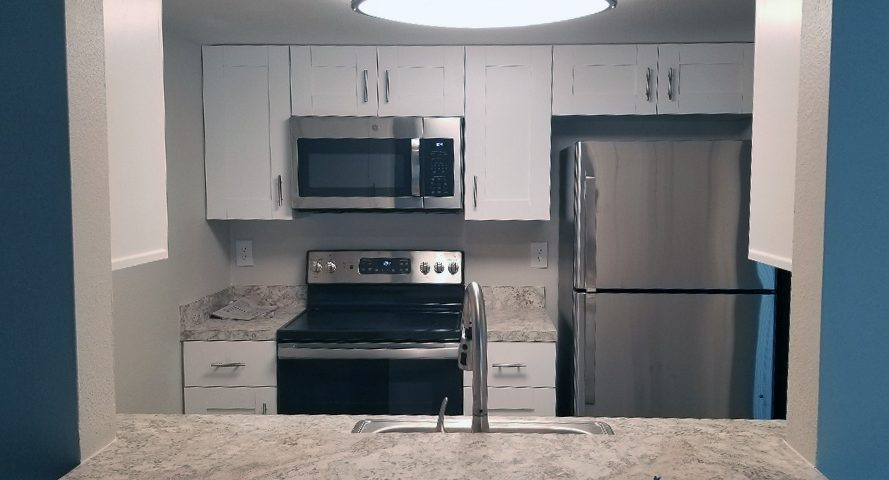 Renovated Kitchen by Think Construction Services