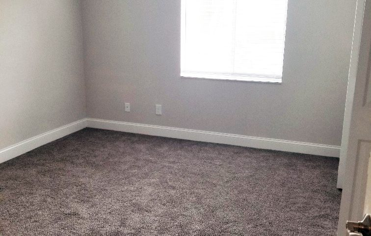 Renovated bedroom with carpet